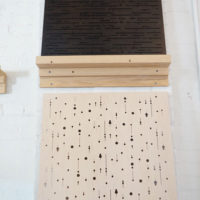 perforated wood panels close up
